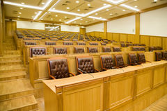 Conference halls with armchairs and tables Stock Photos