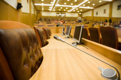 Conference halls with leather armchairs and tables Stock Image