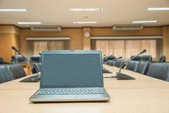 Before a conference,Laptop in front of empty chairs at conferenc Royalty Free Stock Photos