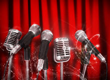 Conference meeting microphones prepared for talker. Over Red Curtains Royalty Free Stock Photo