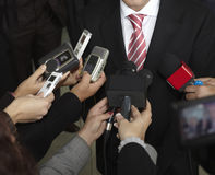 Conference microphones. Close up of conference meeting microphones and businessman Royalty Free Stock Photos