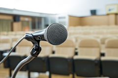 Before a conference, the microphones in front of empty chairs. Stock Photos