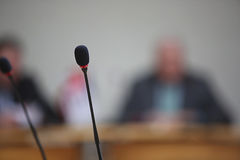 Conference, the microphones in front Royalty Free Stock Photography