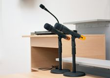 Conference microphones II. Shot of conference microphones in the auditorium Royalty Free Stock Photos