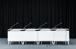 Conference microphones in a meeting room. Monochrome picture of conference stand table with microphones in a meeting room Stock Images