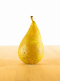 Conference pear. On a chopping board and white background Stock Image