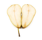 Conference pear sliced in half and laid open Royalty Free Stock Photography