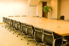 A conference room. Conference table and chair in a conference room stock image