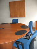 Conference room. Blue chairs and wood table Stock Images