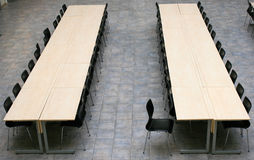 Conference room. Two tables with black chairs stock photos