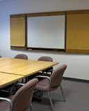 Conference room. A generic conference room, with a blank whiteboard where text could be inserted royalty free stock photography