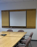 Conference room. A generic empty conference room, with a conference phone on the table, and empty whiteboard. Crop is vertical Stock Photo