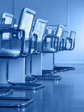 Conference room. Chairs in the conference room; blackboard on the background; blue tint stock photos