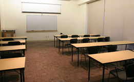 Conference Room. Conference/class room with desks and blank whiteboard Stock Images