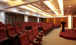 Conference Room. Shot of an upscale Conference / Meeting Room with rows of red chairs royalty free stock photos