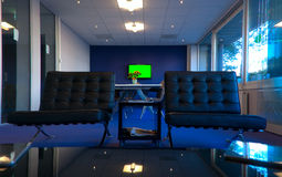 Conference room. Small meeting room (green color on the TV can be replaced with your picture Stock Image