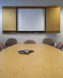 Conference room. An empty conference room with a blank whiteboard and conference phone Stock Photos