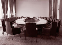 Conference room. With oval table in sepia royalty free stock images