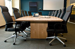 Conference room. With executive chairs, screen and phone Stock Photography