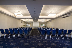 Conference room. A conference and meeting room with chairs and tables Royalty Free Stock Images