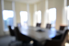 Conference room background blurred. A soft-focus conference room with windows for a background royalty free stock images