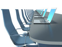 Conference room with black table and chairs and laptops Stock Photography