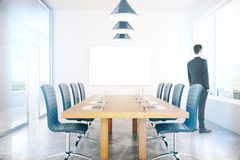 Conference room with businessman. Conference room interior with blank board and businessman. Mock up, 3D Rendering Stock Photography