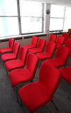Conference Room Chairs. Red chairs in a conference room Stock Photo