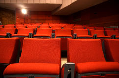 Conference room chairs. Empty red seats at cinema or theater stock images