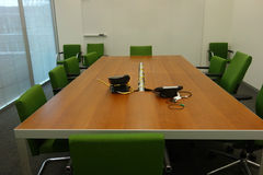 Conference Room. A conference room with chairs around a table, phones and a white board stock photography