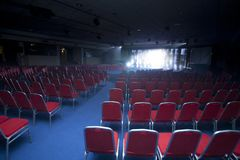 Conference room. With chairs and big screen Stock Photo