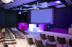 Conference room. With chairs and big screen Royalty Free Stock Photo