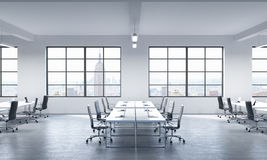 A conference room or corporate workplaces equipped by modern laptops in a modern panoramic office in New York.. Black leather chairs and a white table. 3D Stock Image