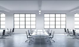 A conference room or corporate workplaces equipped by modern laptops in a modern panoramic office with white windows. Black leathe Royalty Free Stock Photography