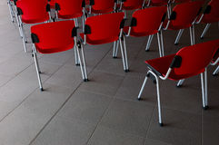 Conference room - detail of seats (1/6). Conference room - detail of red seats Stock Images