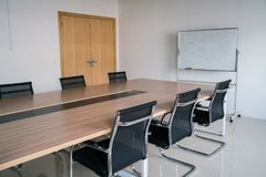 Conference room. Empty conference room with board room table and chairs royalty free stock photos