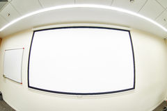 Conference room empty projector screen Royalty Free Stock Image