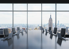 A conference room equipped by modern laptops in a modern panoramic office in New York. Black leather chairs. Stock Images