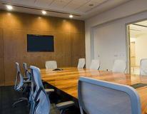 Conference Room Interior. With Wood Paneling and Lights Royalty Free Stock Image