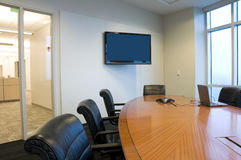 Conference Room Interior. With Windows and Flat Screen TV Stock Image