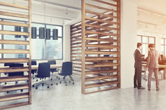 Conference room interior, plank walls side, men Royalty Free Stock Images