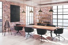 Conference room interior with poster. Side view of modern red brick loft conference room interior with empty poster, equipment and city view. Mock up, 3D Stock Photos