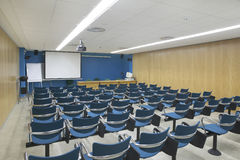 Conference room interior with projector and screen. Horizontal Royalty Free Stock Image