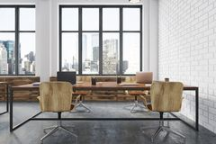 White brick meeting room interior side. Conference room interior with white brick walls, a concrete floor, large windows and a long wooden table with wooden Royalty Free Stock Photos