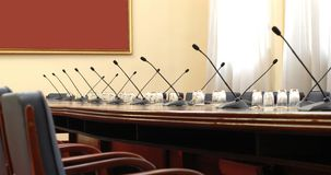 Conference room with microphones Stock Images