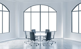 A conference room in a modern office with white copy space in windows. White table and black chairs. Royalty Free Stock Photos