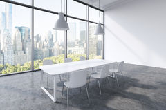 A conference room in a modern panoramic office with New York city view. White table, white chairs and two white ceiling lights. 3D Stock Photo