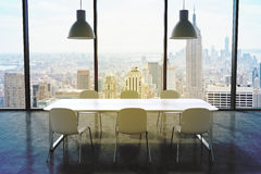 A conference room in a modern panoramic office with New York city view. White table, white chairs and two white ceiling lights. 3D Stock Photography