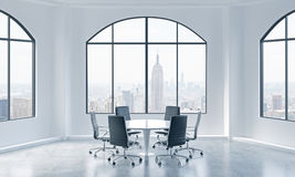 A conference room in a modern panoramic office with New York view. White table and black chairs. Stock Image