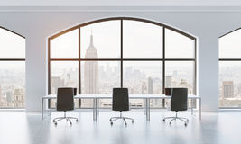 A conference room in a modern panoramic office with New York view. White table and black chairs. 3D rendering. Stock Photography